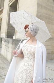 范冰冰白色镂空连衣裙亮相时装周 与泰国公主撞衫