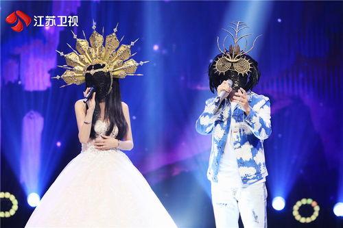 蒙面唱将猜猜猜hello树先生王铮亮揭面猜评团给了他最高赞誉