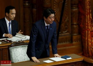 日本参议院否决问责决议案安倍鞠躬致谢